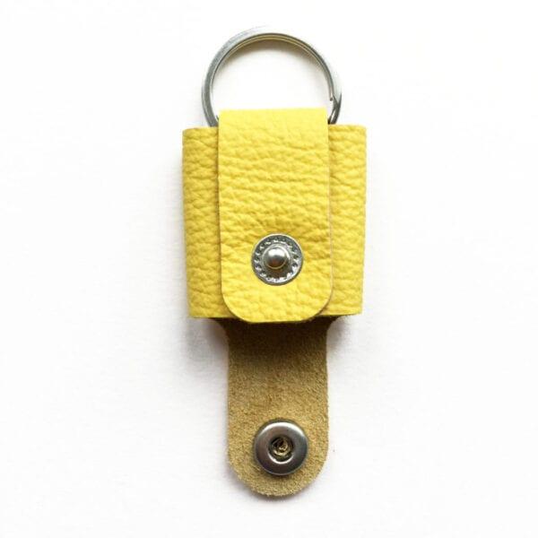 USMEUS pung nøglering åben sol gul